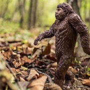 An action figure of bigfoot walking through the forest signifying millennials.
